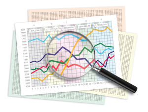 Magnifying glass over a line graph chart